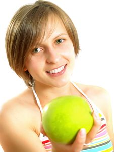 Free Cute Girl Giving A Green Apple Stock Photos - 10074253