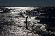 Free Alone Boy In The Sea Royalty Free Stock Image - 10075256