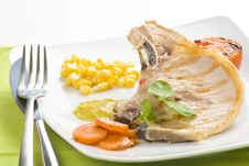 Free Tasty Pork Chop With Corn Carrot Tomato Stock Photo - 10075340