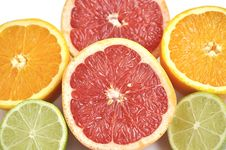 Free Background Of Cut Grapefruit, Orange And Lime. Royalty Free Stock Photography - 10075387