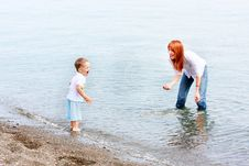 Free Mother And Son On Beach Stock Photos - 10075483
