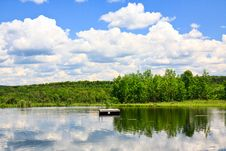 Free Pond And Clouds Stock Image - 10077271