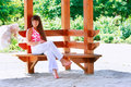 Free Girl Sitting On Wooden Bench In Park Stock Photos - 10088653