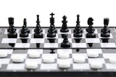 Checkers Against Chess Royalty Free Stock Image