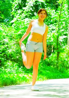 Woman Runner In The Woods Stock Image