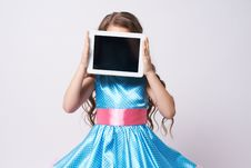Free Girl. Tablet. Portrait Child. Dress. Blue. Technologies Stock Photo - 100853400