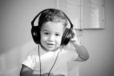 Free Boy In Big Headphones Royalty Free Stock Photos - 10095598