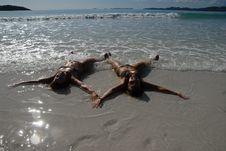 Two Teenage Girls Lying On The Beach Stock Photography
