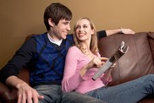 Free Couple Reading On The Couch Stock Photo - 10096570