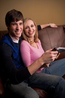 Happy Couple On The Couch Royalty Free Stock Image