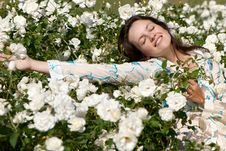 Free Fine Young Women In Roses Stock Photos - 10099253