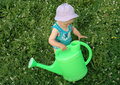 Free Litlle Girl And Watering-pot Royalty Free Stock Photos - 1010848