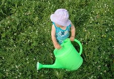 Free Litlle Girl And Watering-pot Stock Image - 1010821