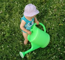 Free Litlle Girl And Watering-pot Stock Images - 1010834