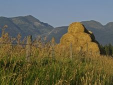 Stacked Hay And Mountains Stock Photo