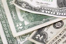 Free Two Dollar Bills - Horizontal - Narrow Depth Of Field Royalty Free Stock Photos - 1016768
