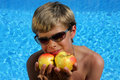 Free Smiling Boy With Sun Glasses Presenting Apples Royalty Free Stock Images - 10104889
