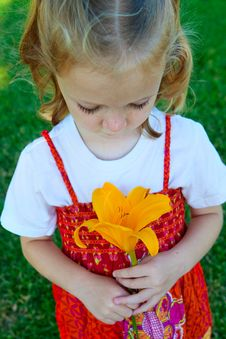 Free Girl With Yellow Flower Stock Photos - 10103523