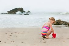 Free Girl Playing In The Sand Royalty Free Stock Photos - 10103628