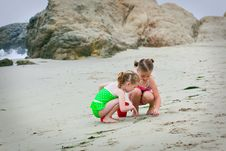 Girls Playing In The Sand Royalty Free Stock Image