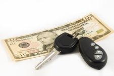 Car Key And A Ten US Dollar Bill Stock Images