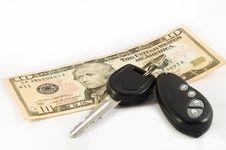 Car Key And A Ten US Dollar Bill