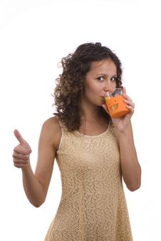 Free Woman Is Drinking Orange Juice And Showing OK. Royalty Free Stock Photography - 10107957