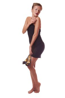 Free Woman In Black Dress Hold Shoes In Hand Royalty Free Stock Images - 10108229