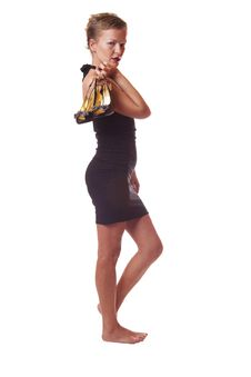 Free Woman In Black Dress Hold Shoes In Hand Royalty Free Stock Photography - 10108327