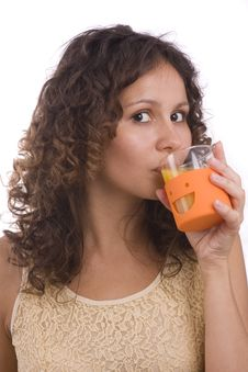 Free Girl Is Drinking Orange Juice. Stock Image - 10109061