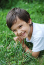 Free Child Laying On The Grass Stock Photography - 10113482