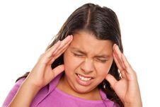 Pretty Hispanic Girl With Headache Royalty Free Stock Photos