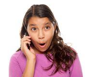 Shocked Pretty Hispanic Girl On Cell Phone Stock Photo
