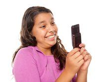 Happy Pretty Hispanic Girl On Cell Phone Stock Photos