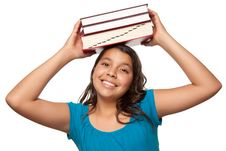 Pretty Hispanic Girl With Books On Her Head Royalty Free Stock Images