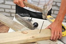 Free Hammer Pounding Nail Stock Photography - 10110492