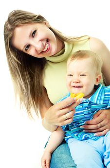 Mother Feeding A Baby Stock Images