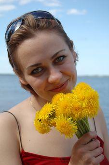 Girl Holding Yellow Flowers Stock Image