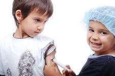 Free Two Kids Playing Doctors Stock Photo - 10114070