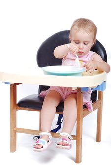 Baby Sitting On The Black Chair Isolated Stock Image