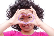 Girl With Heart Shaped Hands Stock Photo