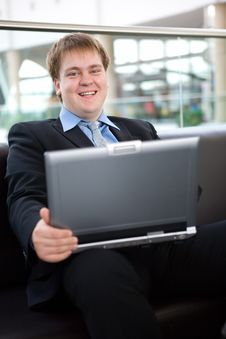 Happy Young Businessman With Laptop Royalty Free Stock Photo