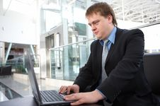 Happy Young Businessman With Laptop Stock Photography