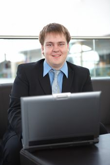 Happy Young Businessman With Laptop Royalty Free Stock Photography