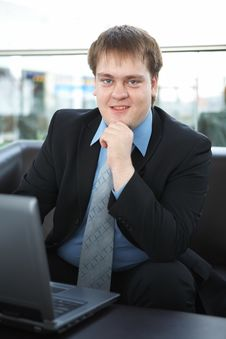 Happy Young Businessman With Laptop Royalty Free Stock Photos