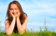 Free Young Woman Lying On The Green Grass Royalty Free Stock Photo - 10116785