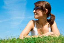 Free Young Woman Lying On The Green Grass Stock Image - 10116811