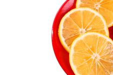 Three Slice Of Orange On A Red Plate Stock Image