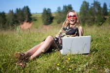 The Girl Sits At The Laptop On The Nature Royalty Free Stock Image