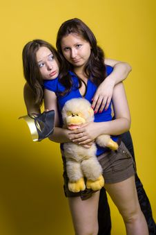 Free Two Happy Friends Girl With Yellow Toy Stock Images - 10120524